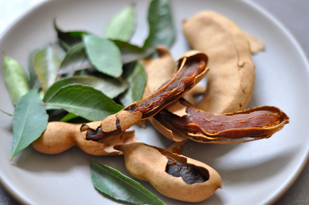 Tamarind pods and curry leaves give rasam broth a lemony-sweet tang and a subtle bitter flavor