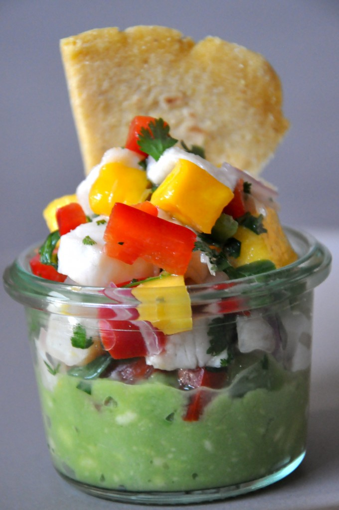 Mini ceviche appetizer with gaucamole at the bottom