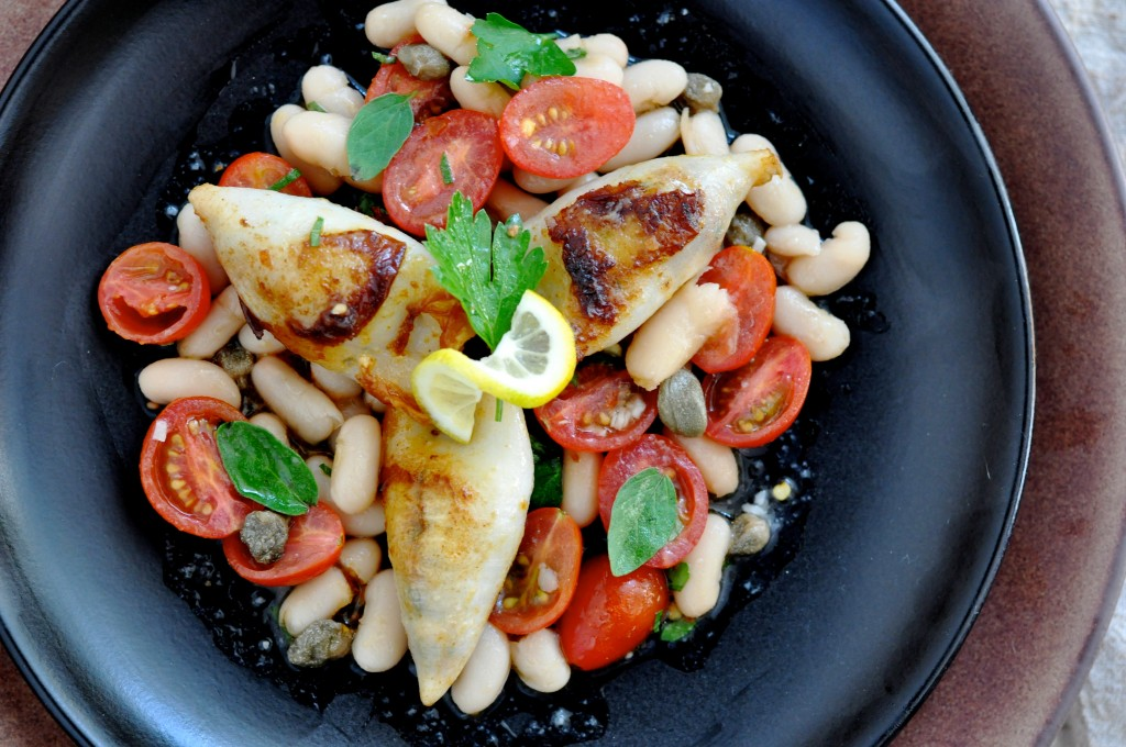 Marinated white beans salad with: cherry tomato, oregano, lemon juice, garlic, and parsley