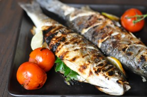 Grilled Branzini stuffed with herbs and served with Green Harissa